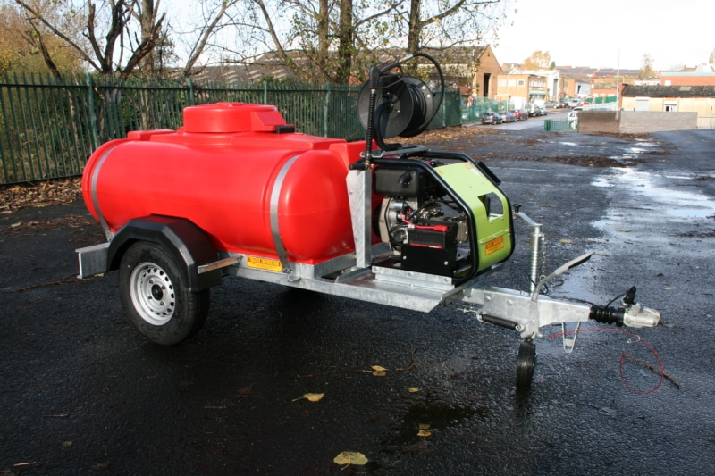 Red water trailer with 3000 psi pressure washer and hose reel
